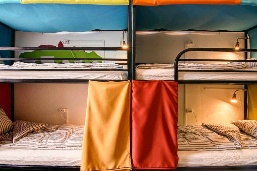 Bunk beds with privacy curtains at Pal's Mini Hostel at Octogon