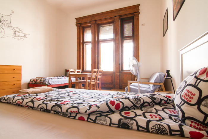 Apartment with bed and big window